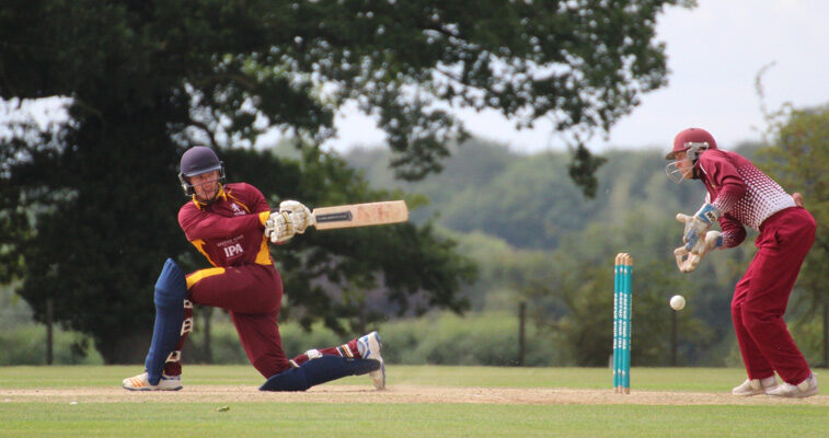 Ben Parker – Ben Parker sweeps the ball for four on his way to top-scoring with 65 for Suffolk in the second match as Cambridgeshire wicket-keeper Josh Bowers looks on Photograph: NICK GARNHAM